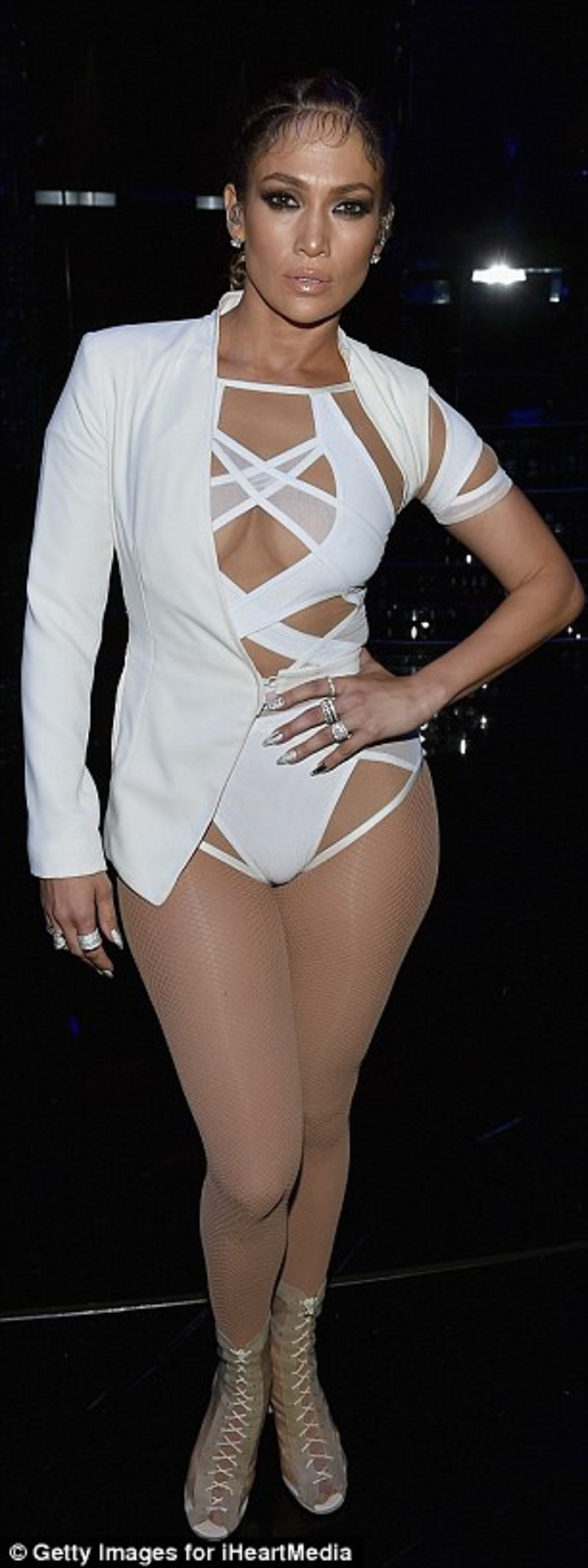 2C88B29500000578-3241785-Putting_on_a_show_Jennifer_Lopez_flashed_the_flesh_at_the_iHeart-a-23_1442746465527