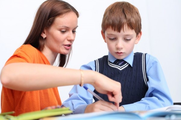 bigstock-mother-or-teacher-helping-kid-38891440