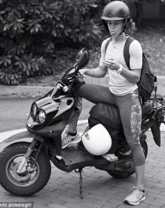 2D5E732E00000578-3270660-Just_checking_A_moped_rider_stops_to_look_at_her_phone-a-68_1444741347187