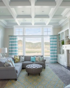 Good-Looking-round-ottoman-coffee-table-in-Family-Room-Transitional-with-Vase-Decoration-next-to-Blue-Grey-Color-Scheme-alongside-Wall-Color-Transition-andL-Shaped-Couch--718x479