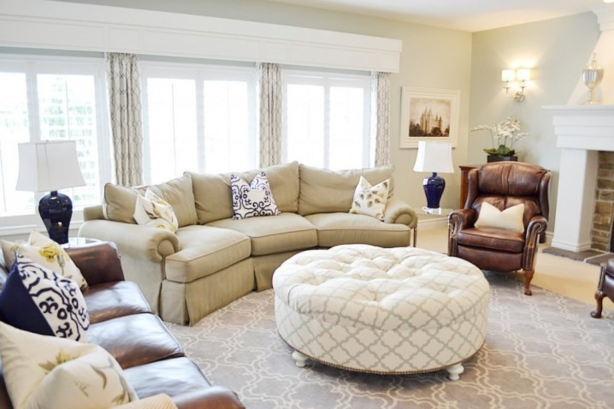 awesome-white-round-upholstered-ottoman-coffee-table-plus-contemporary-living-room-furniture-decorating-and-brown-leather-sofa-with-end-table-as-well-as-armchair-design-ideas-718x478