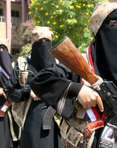 Fighters of the Popular Resistance Committees stand during a graduation ceremony of the affiliate special forces of the Popular Resistance, in Yemen's southwestern city of Taiz