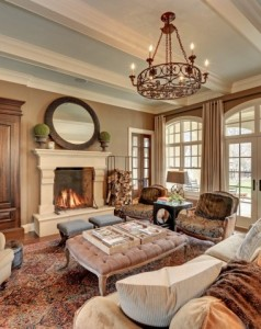 tufted-ottoman-coffee-table-Living-Room-Traditional-with-arched-windows-area-rug-artwork-beige-sofa-beige-walls-built-in-armoire-carved-718x479