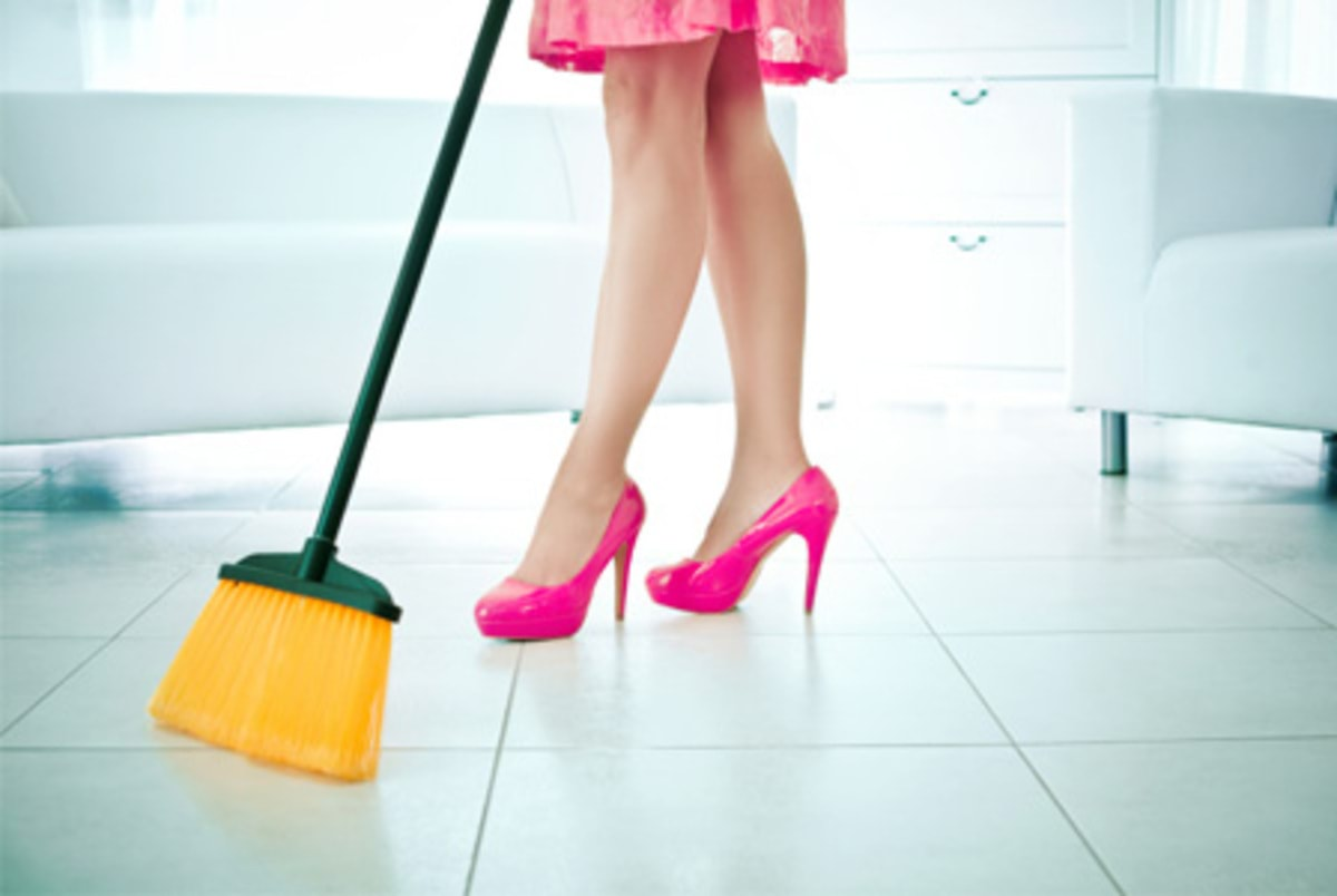 woman-cleaning-with-broom-horiz