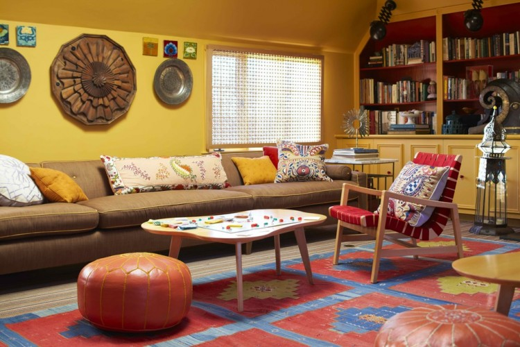 Magnificent-Coral-Pouf-fashion-New-York-Contemporary-Living-Room-Inspiration-with-area-rug-artwork-bold-colors-bookcase-bookshelves-built-in-shelves-colorful-decorative-pillows-library
