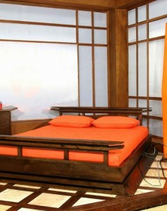 interior-orange-bed-on-brown-wooden-frame-near-orange-floor-lamp-and-brown-wooden-chest-of-drawer-also-brown-wooden-table-side-on-white-brown-rug-amazing-ideas-of-hippie-room-decor-to-inspire-your-int