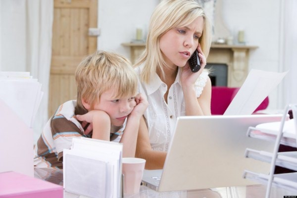 WOMAN-PHONE-CHILD-Payingbills