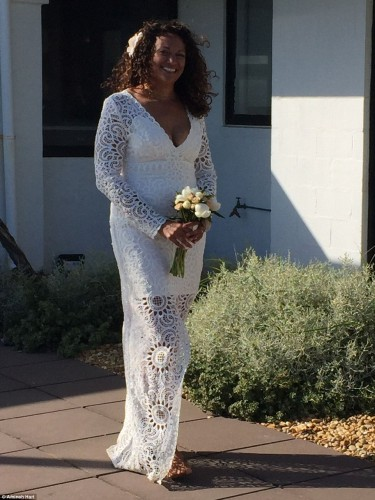 3282546300000578-3507193-Ms_Hart_wore_a_floor_length_white_lace_wedding_dress_with_a_flow-a-48_1458794683840