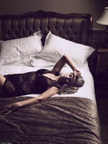 32DE43F100000578-3524617-Nicola_also_poses_on_a_bed_in_black_lace_nightwear_and_drapes_he-a-6_1459923178264