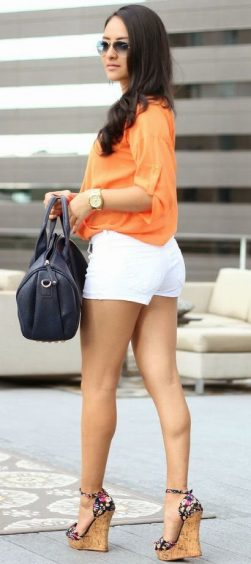 Cute summer style! Tangerine Bebe Top and White Denim Shorts