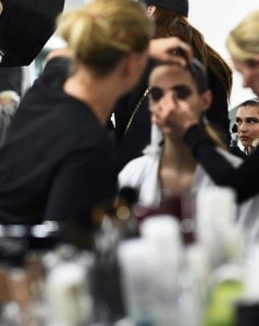 Model Bella Hadid has her make-up applied inside Blenheim Palace ahead of a Dior fashion show in Woodstock