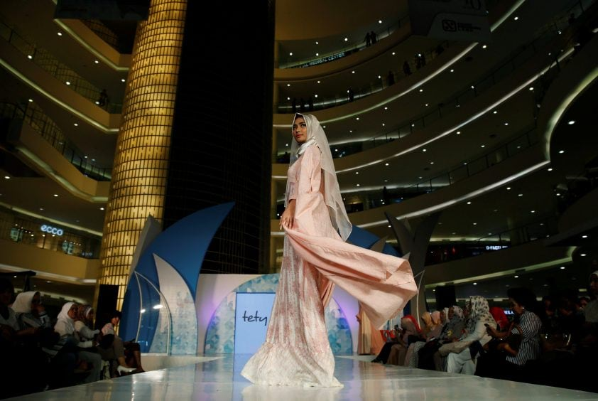 A model presents a creation by Indonesian designer Alphiana Chandrajani at the Ramadhan Fashion Delight at a shopping mall in Jakarta, Indonesia May 27, 2016. REUTERS/Beawiharta