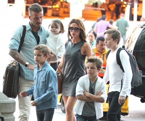 **Exclusive** David Beckham and Victoria Beckham arrive at LAX airport with their four children Romeo, Cruz, Harper and Brooklyn to board a flight Los Angeles, California - 05.07.12 Mandatory Credit: KMA/WENN.com