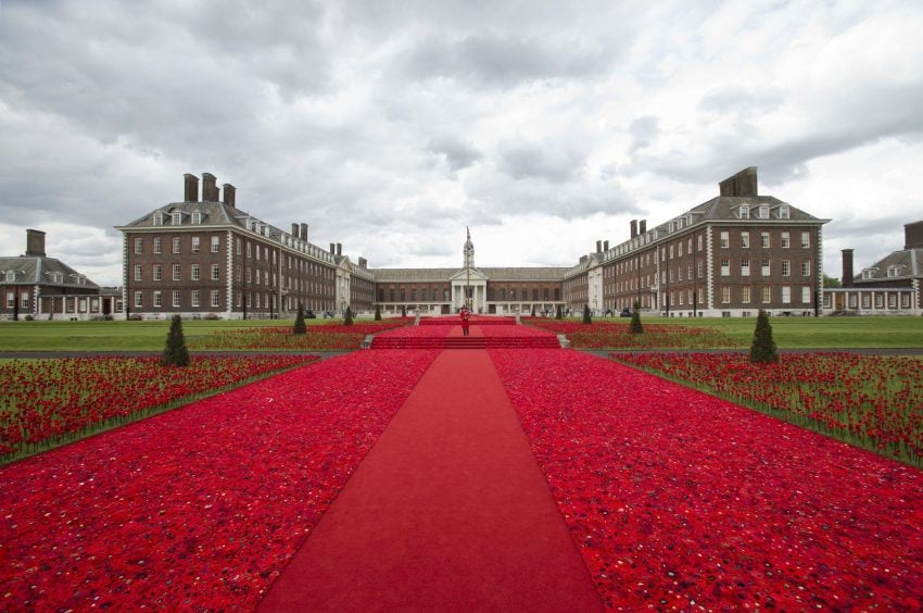 Chelsea Pensioner piper Michael Shanahan, aged 70, playing at the 5000 Poppies exhibit – which uses almost 300,000 individually crocheted poppies, covering nearly 2,000sq m (21,000sq ft) in the grounds of the Royal Hospital Chelsea – during a preview day at the Chelsea Flower Show in London.