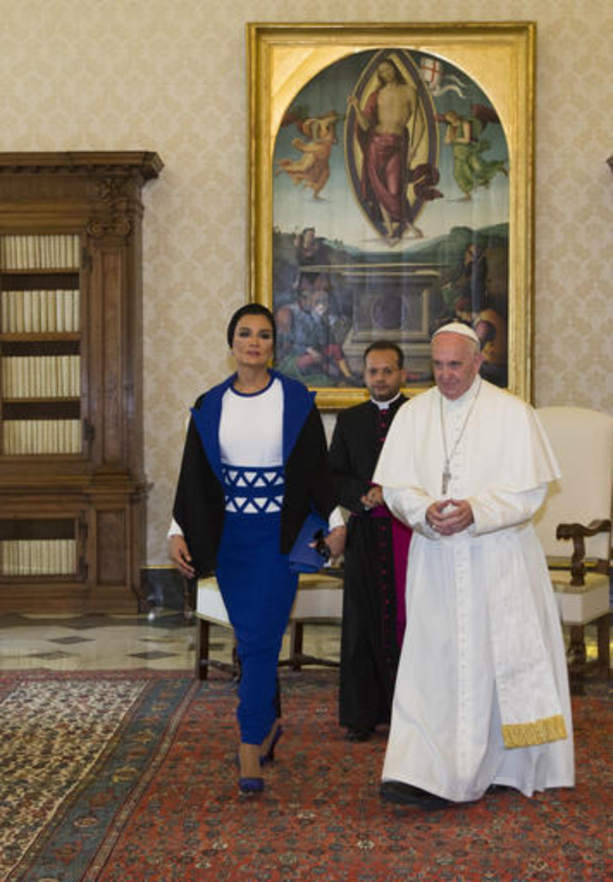 Pope Francis and Qatar's Sheikha Mozah bint Nasser leave at the end of a private audience at the Vatican, Saturday, June 4, 2016. (AP Photo/Alessandra Tarantino, Pool)