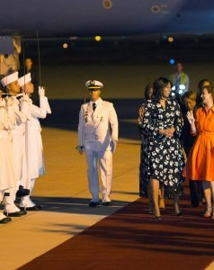 U.S. first lady Michelle Obama is welcomed by Princess Lalla Salma of Morocco as she arrives at the Marrakech International airport