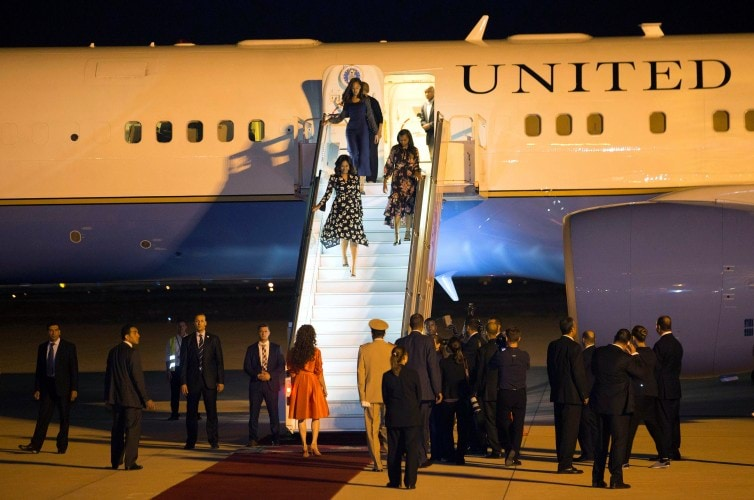 U.S. first lady Michelle Obama walks down from her plane as she is welcomed by Princess Lalla Salma of Morocco at the Marrakech International Airport
