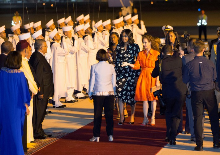 U.S. first lady Michelle Obama with her daughters Sasha and Malia, is welcomed by Princess Lalla Salma of Morocco as she arrives at the Marrakech International Airport