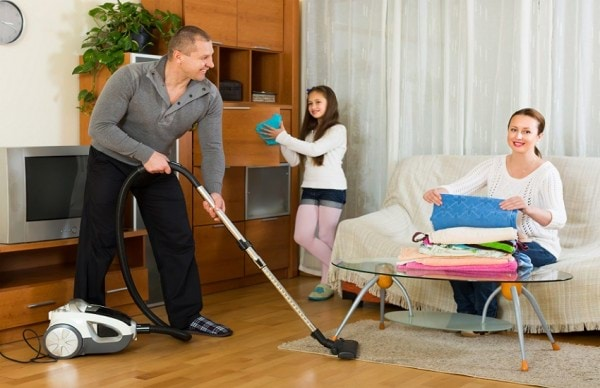 Girl with parents cleaning at home