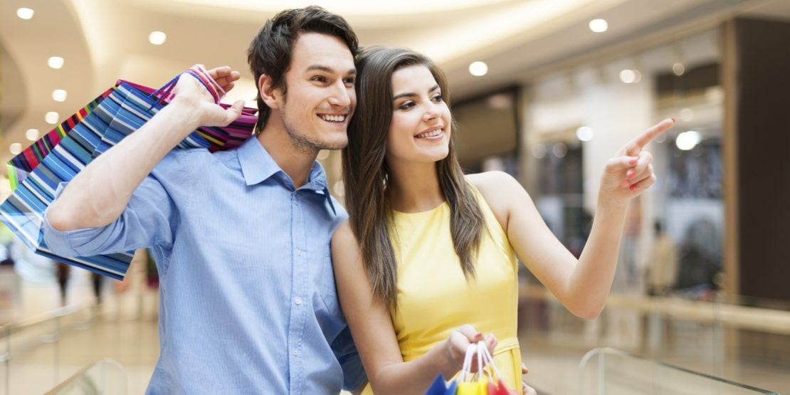 Portrait of happy couple in shopping mall