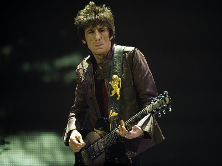"""Ron Wood of the Rolling Stones performs during """"The Stones-50 and Counting"""" tour December 8, 2012 at the Barclays Center in Brooklyn, NY. The band performed it's first American concert celebrating it's 50th anniversary. AFP PHOTO/DON EMMERT        (Photo credit should read DON EMMERT/AFP/Getty Images)"""