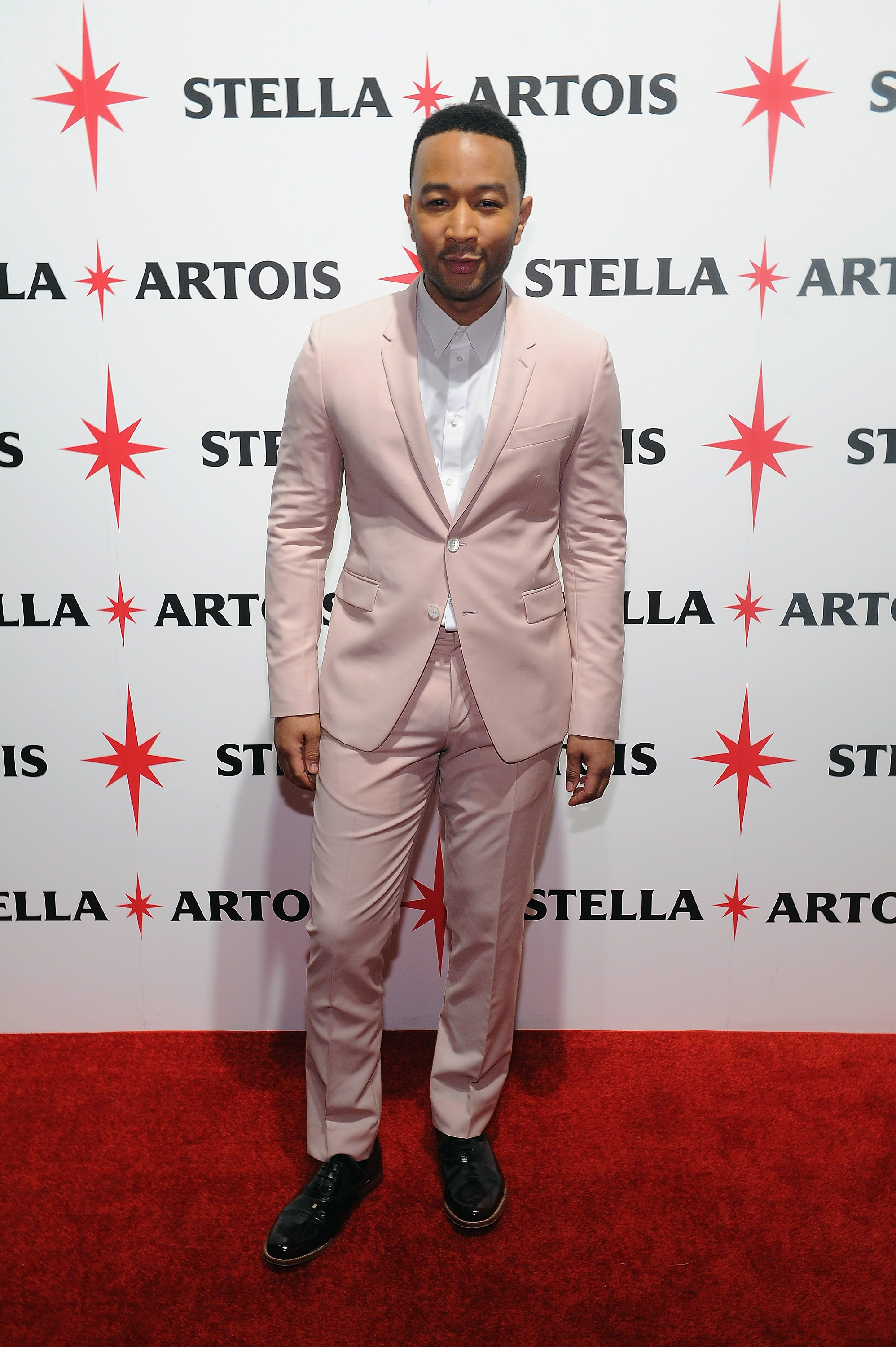 "NEW YORK, NY - DECEMBER 09:  John Legend attends the unveiling of ""Stars"" by Stella Artois where he performed a new holiday song written exclusively for Stella Artois, ""Under the Stars,"" on December 9, 2015 in New York City.  To listen, visit StellaArtois.com.  (Photo by Craig Barritt/Getty Images for Stella Artois)"