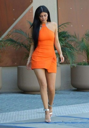 Kylie-Jenner-Leggy-in-Orange-Dress-4