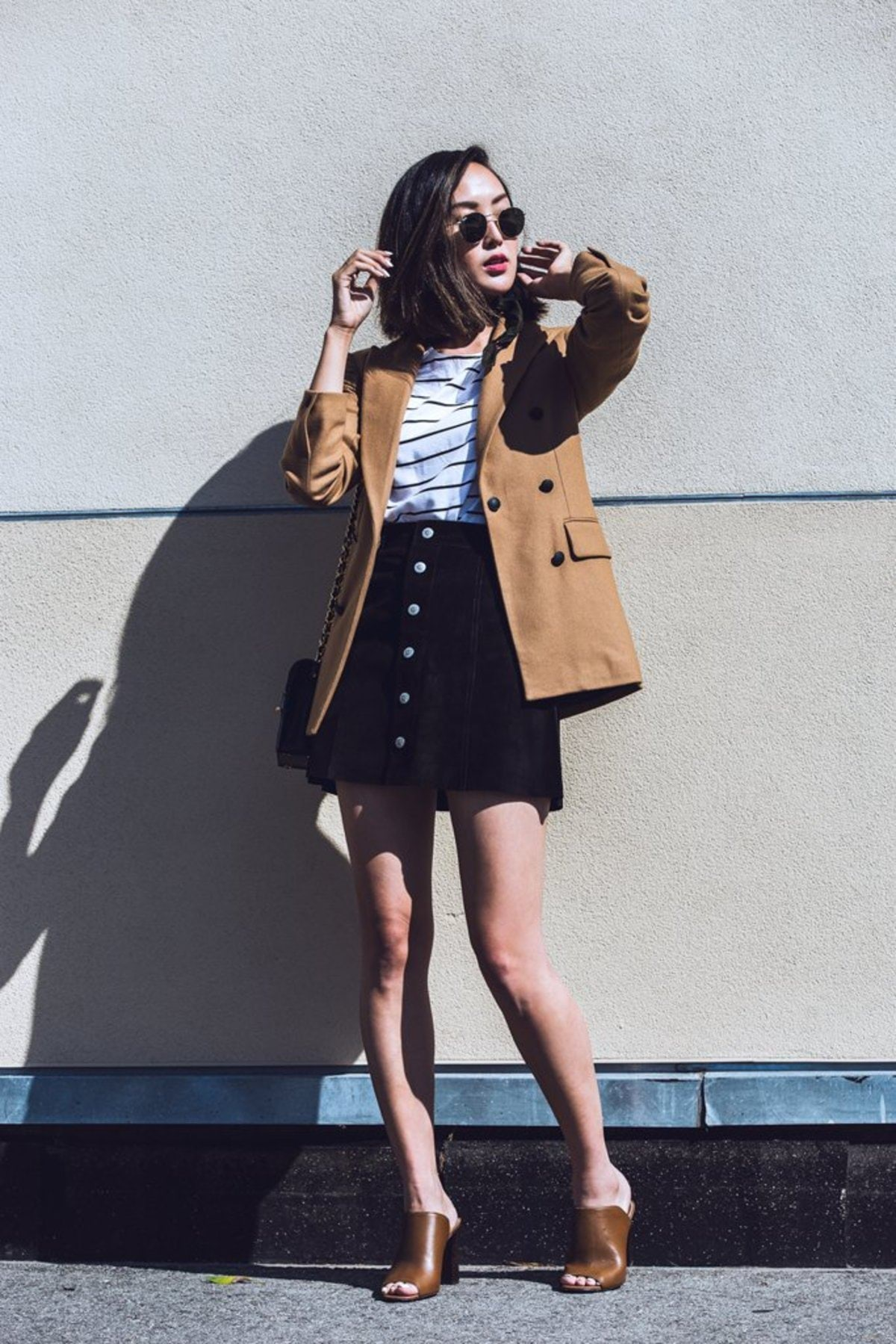 camel-colored-coat-over-striped-tee-suede-skirt-pair-mules