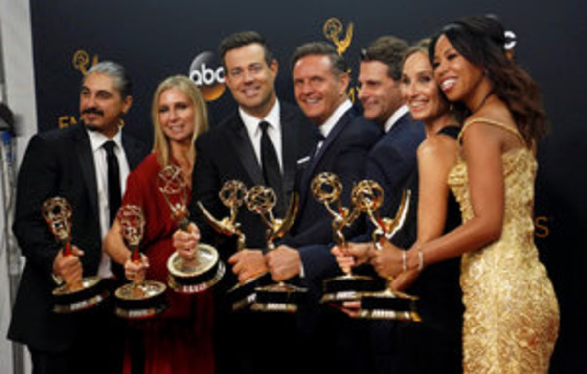 "Producer Mark Burnett (C) and host Carson Daly (3rd L) pose with his team backstage with their award for Outstanding Reality-Competition Program for ""The Voice"" at the 68th Primetime Emmy Awards in Los Angeles, California U.S., September 18, 2016.  REUTERS/Mario Anzuon     TPX IMAGES OF THE DAY"