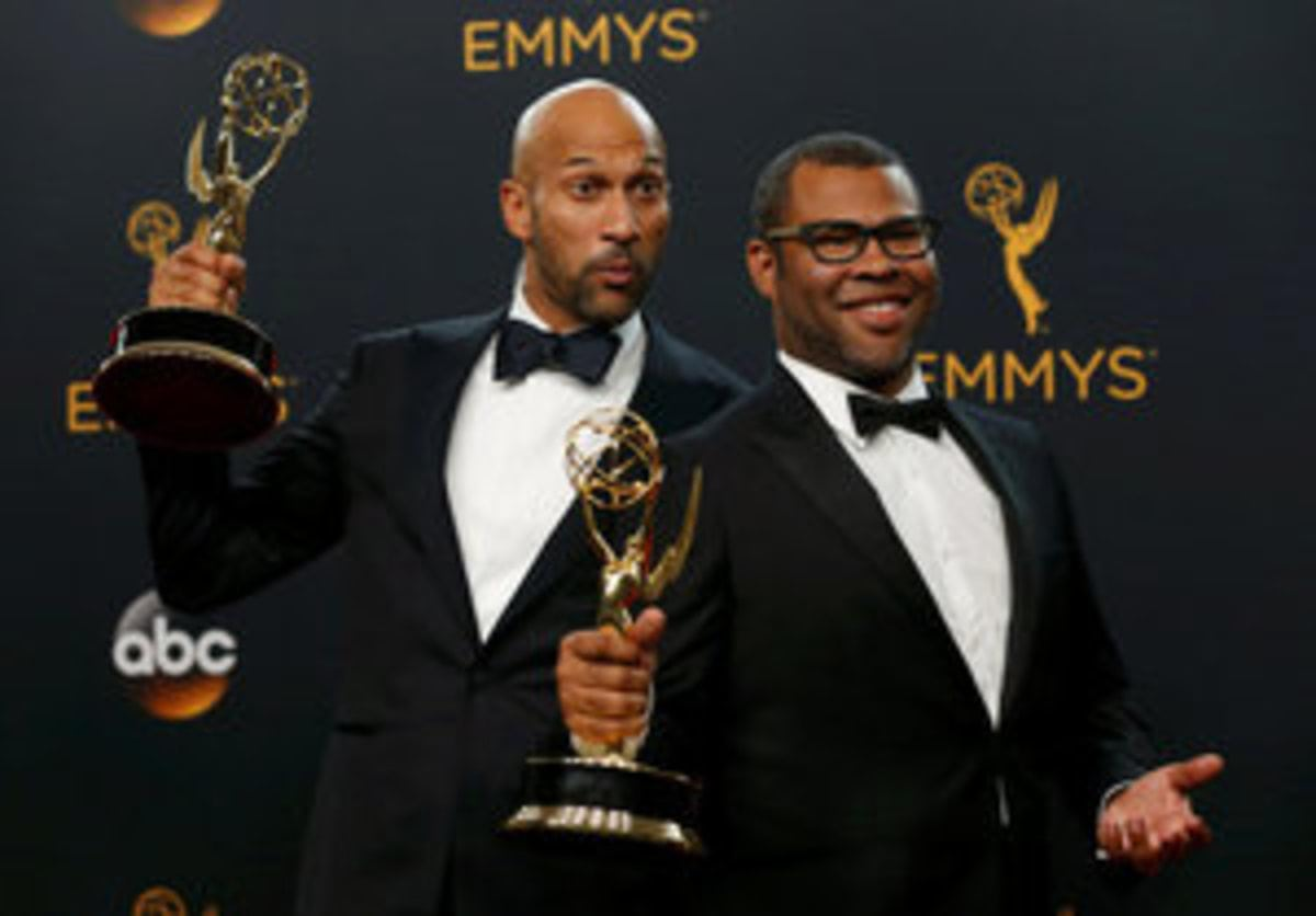 "Keegan-Michael Key (L) and Jordan Peele pose backstage with their award for Outstanding Variety Sketch Series for ""Key & Peele"" at the 68th Primetime Emmy Awards in Los Angeles, California U.S., September 18, 2016.  REUTERS/Mario Anzuoni     TPX IMAGES OF THE DAY"