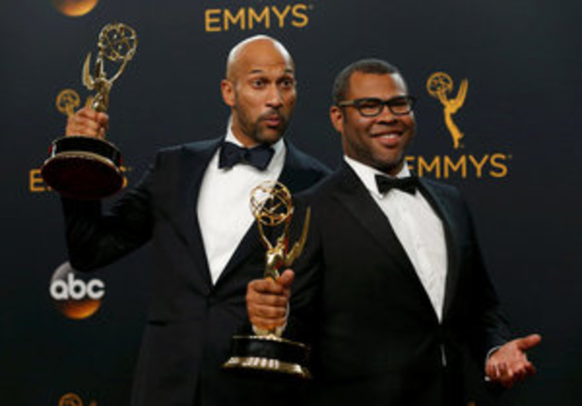 """Keegan-Michael Key (L) and Jordan Peele pose backstage with their award for Outstanding Variety Sketch Series for """"Key & Peele"""" at the 68th Primetime Emmy Awards in Los Angeles, California U.S., September 18, 2016.  REUTERS/Mario Anzuoni     TPX IMAGES OF THE DAY"""