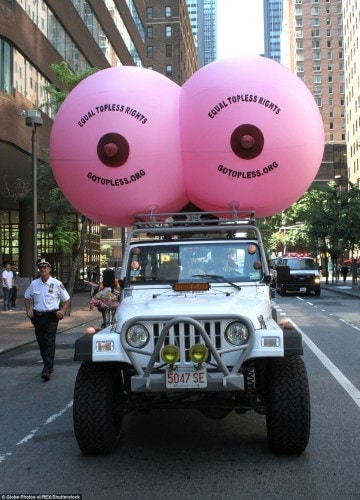 37A99A0F00000578-3766571-Women_marched_behind_a_giant_inflatable_pink_breast_that_had_the-a-22_1472639042093