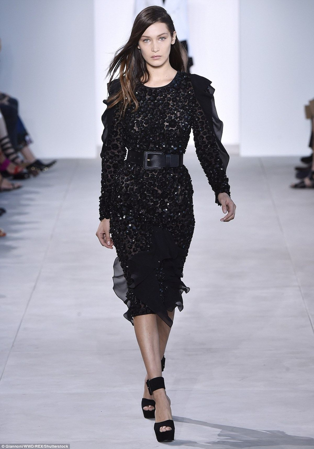 3859BCA100000578-3789419-Before_the_fall_The_teen_was_showing_off_a_black_sequined_dress-a-12_1473873111024
