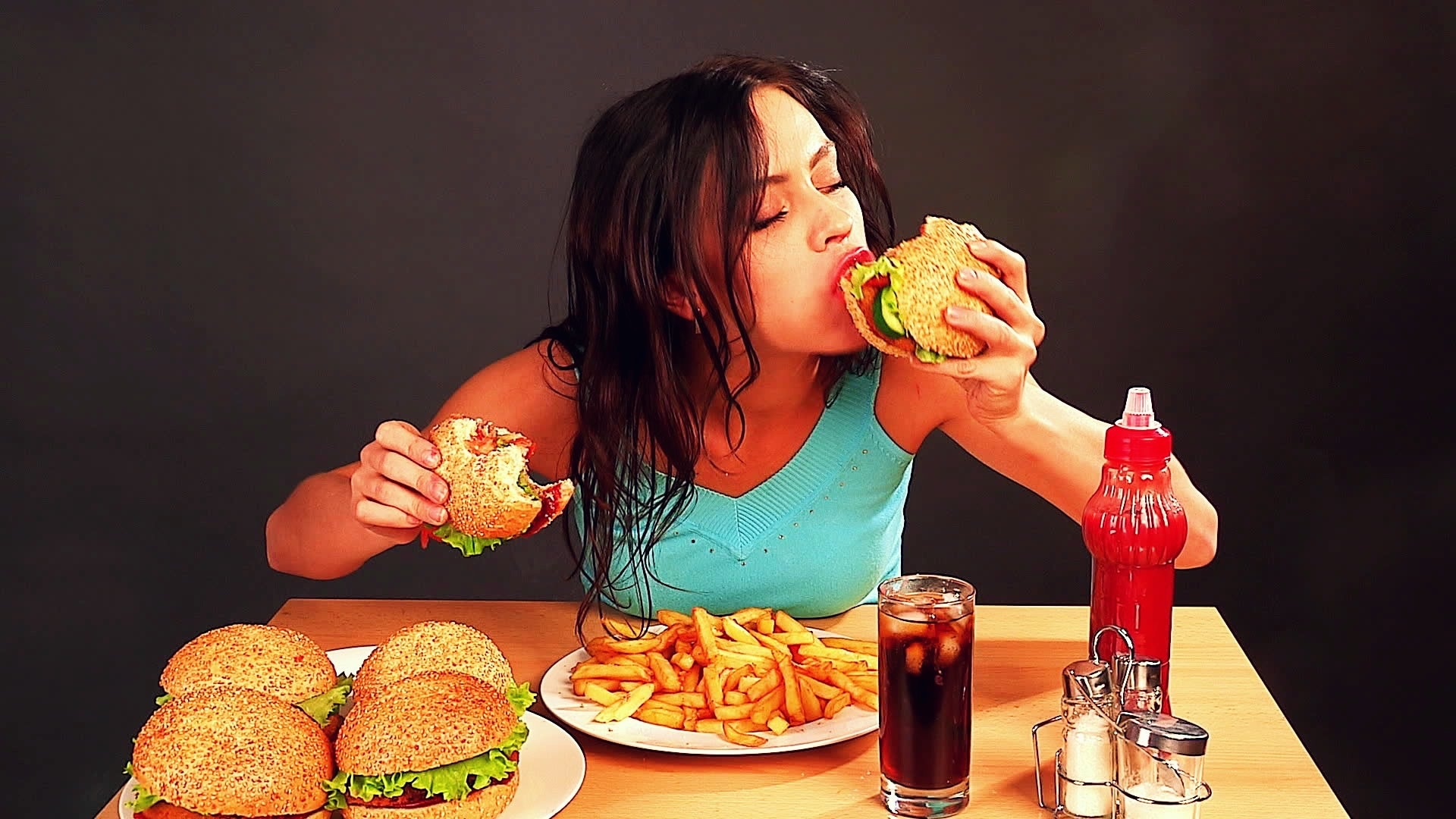 stock-footage-woman-eating-fast-food-time-lapse1