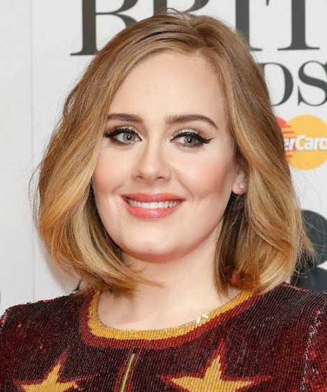 LONDON, ENGLAND – FEBRUARY 24:  Adele poses in the winners room at the BRIT Awards 2016 with her 4 Brit awards at The O2 Arena on February 24, 2016 in London, England.  (Photo by Luca Teuchmann/Getty Images)