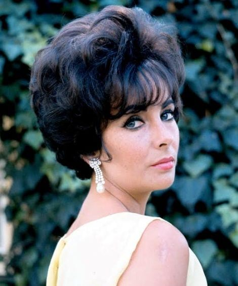 Elizabeth Taylor (1932-2011), British actress, looking over her shoulder, against a background of ivy leaves, circa 1960. (Photo by Silver Screen Collection/Getty Images)