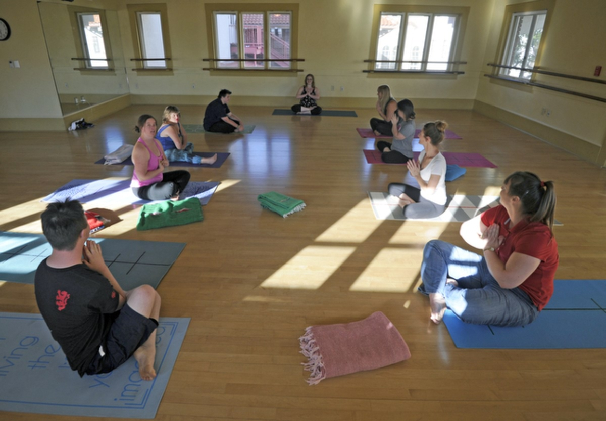 Jessica Parsons, a certified yoga instructor  born with down syndrome leads the ÒInclusive Yoga for All AbilitiesÓ class at the Carillo Rec Center. (May 15, 2015)