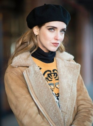 NEW YORK, NY - FEBRUARY 14: Chiara Ferragni is wearing a vintage skirt, Stuart Weitzman boots, Gucci sweater, Acne Studios coat, vintage beret, Supermarket sunglasses, Cartier ring and HermsÊbag seen in the streets of Manhattan during New York Fashion Week: Women's Fall/Winter 2016 on February 14, 2016 in New York City. (Photo by Timur Emek/Getty Images)