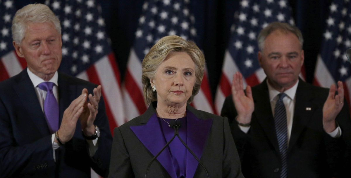Hillary Clinton, accompanied by her husband former U.S. President Bill Clinton (L) and running mate Senator Tim Kaine, addresses her staff and supporters about the results of the U.S. election at a hotel in New York, November 9, 2016. REUTERS/Carlos Barria TPX IMAGES OF THE DAY