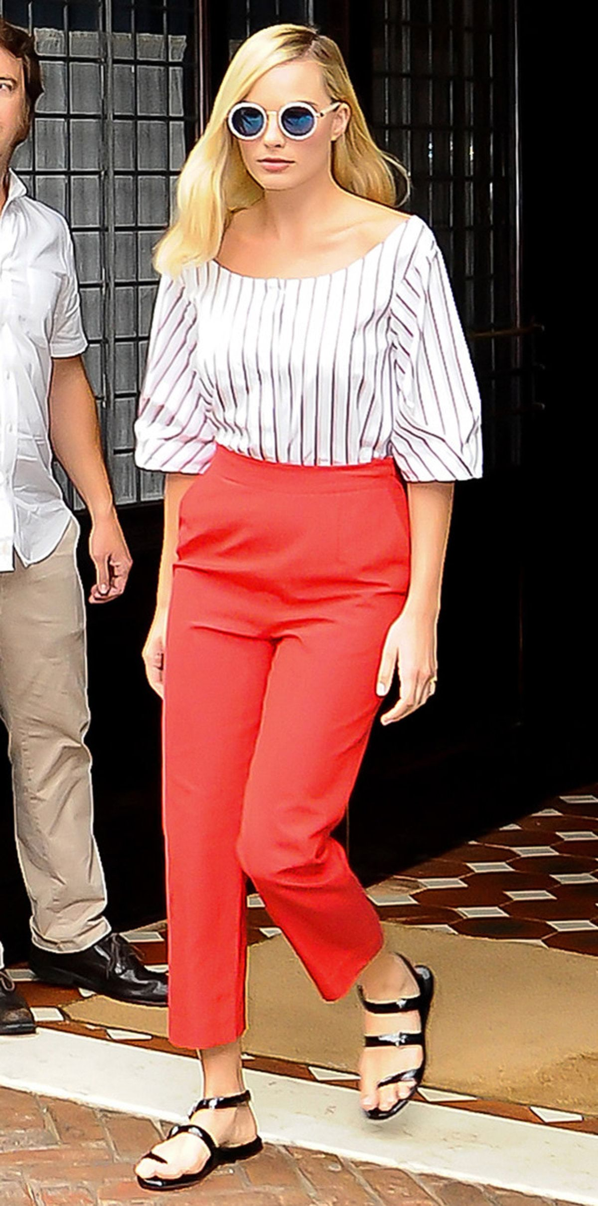 New York, NY - New York, NY - Actress Margot Robbie exits the Greenwich Hotel looking cute and casual in a stripe blouse with red capri trousers, strap sandals and cool pair of blue mirrored sunglasses. AKM-GSI July 29, 2016 To License These Photos, Please Contact: Maria Buda (917) 242-1505 mbuda@akmgsi.com sales@akmgsi.com or Mark Satter (317) 691-9592 msatter@akmgsi.com sales@akmgsi.com www.akmgsi.com AKM-GSI 29 JULY 2016 To License These Photos, Please Contact : Maria Buda (917) 242-1505 mbuda@akmgsi.com or Mark Satter (317) 691-9592 msatter@akmgsi.com sales@akmgsi.com