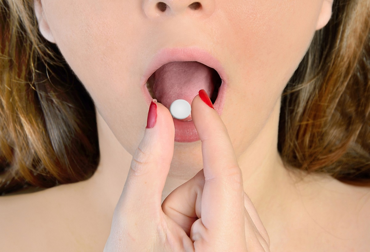 woman-taking-birth-control-pill