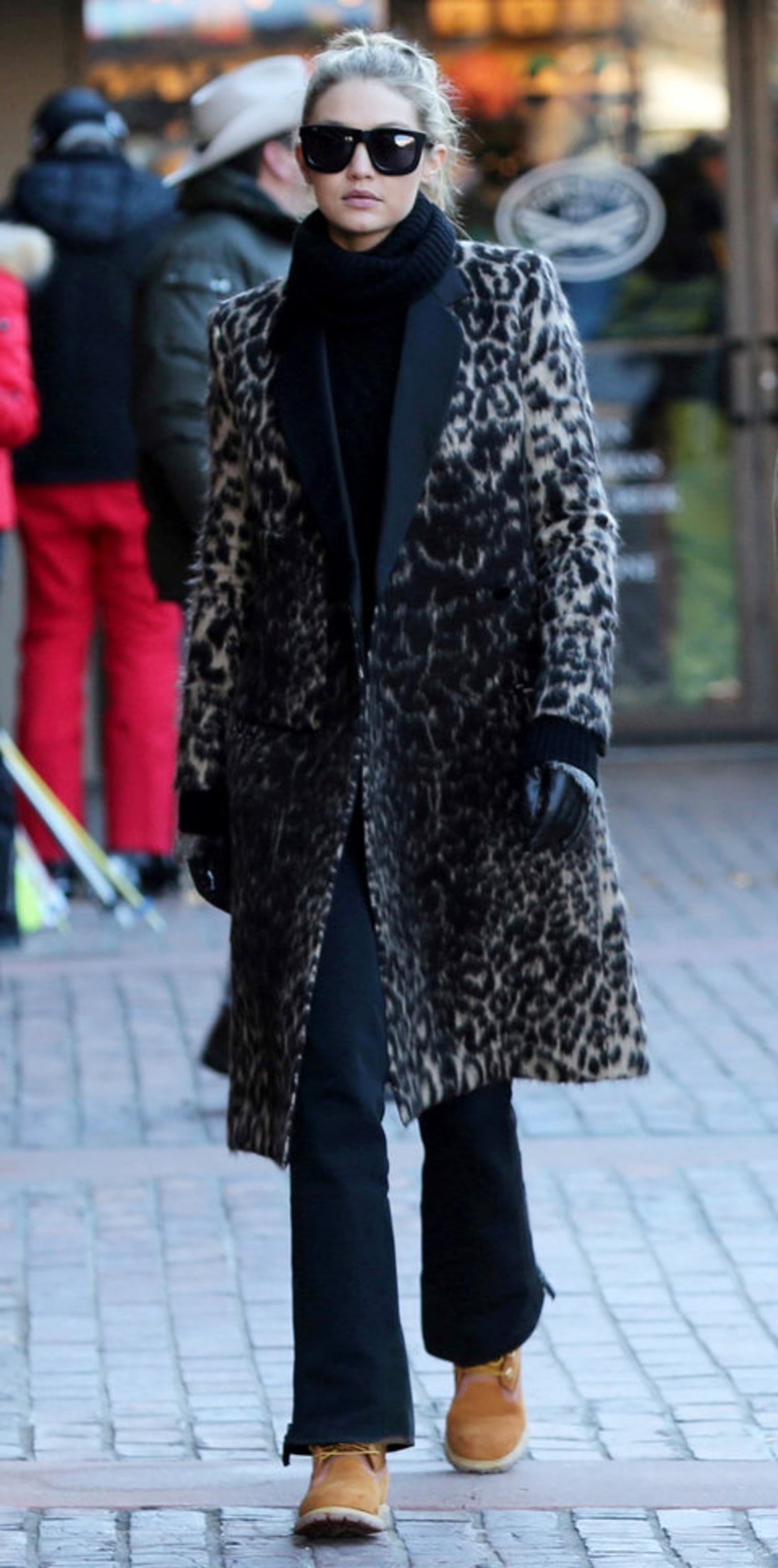 *EXCLUSIVE* Aspen, CO - *EXCLUSIVE* Aspen, CO - Gigi Hadid steps out in Aspen with her family. They head to catch the gondola ride up to dine at the top of the mountain. The model is wearing black on black with a leopard print satin lined jacket paired with classic Timberland boots. 12/27/2015 Copyright © 2014 AKM-GSI, Inc. To License These Photos, Please Contact : Maria Buda (917) 242-1505 mbuda@akmgsi.com or Steve Ginsburg (310) 505-8447 (323) 423-9397 steve@akmgsi.com sales@akmgsi.com