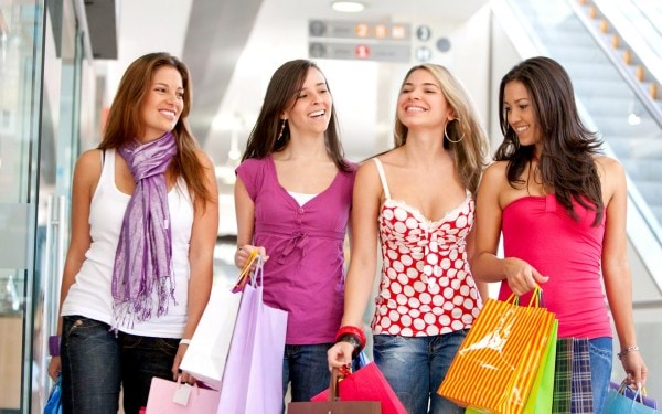 group of friends shopping in a mall