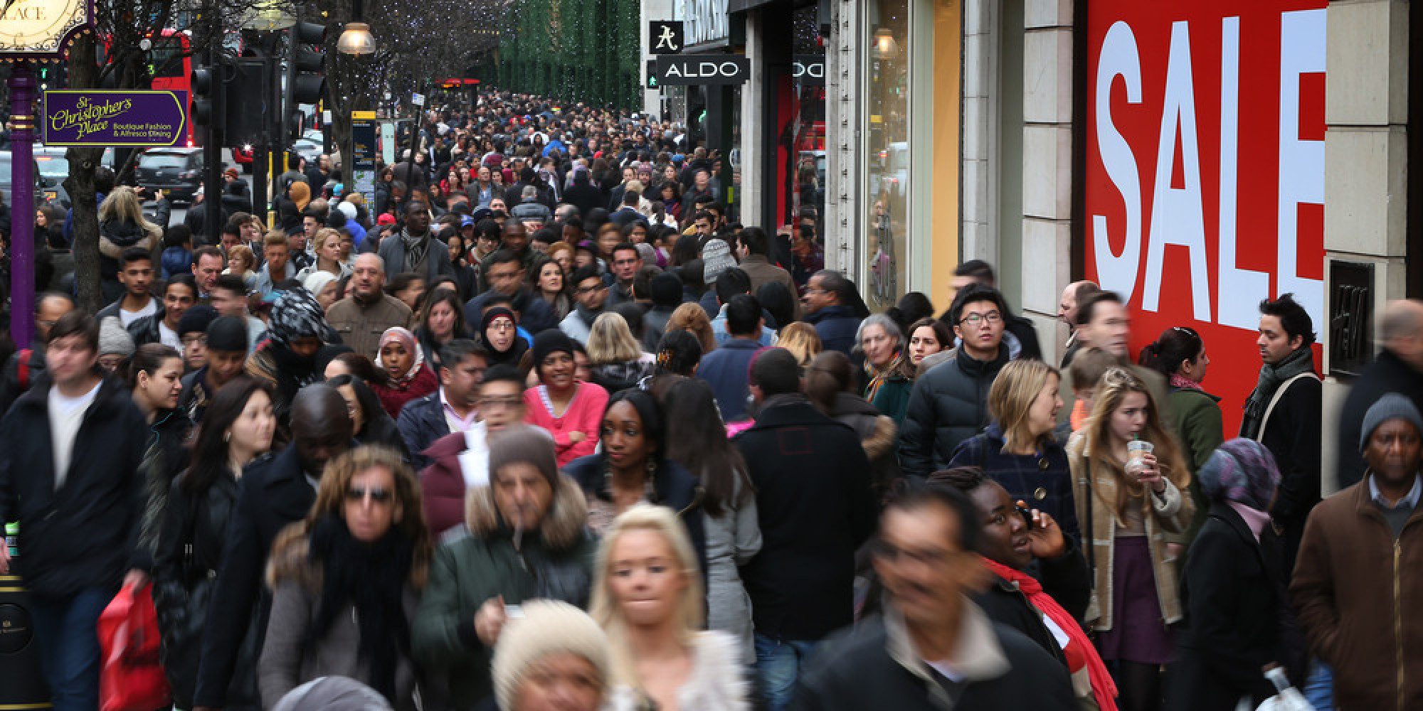 LONDON, ENGLAND - DECEMBER 26: Shoppers fill Oxford Street on December 26, 2012 in London, England. Thousands of shoppers are in London looking for a bargain in the traditional Boxing Day sales. (Photo by Peter Macdiarmid/Getty Images)