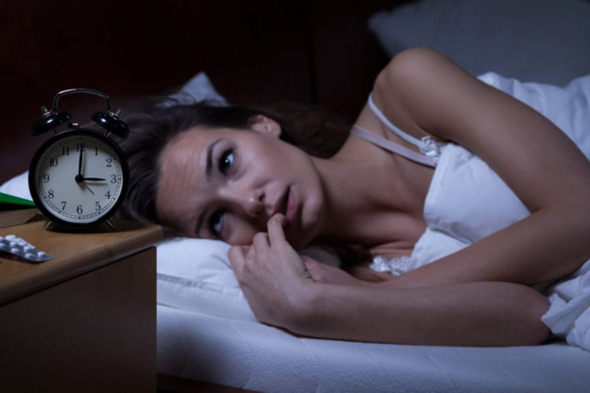 Woman lying in bed sleepless