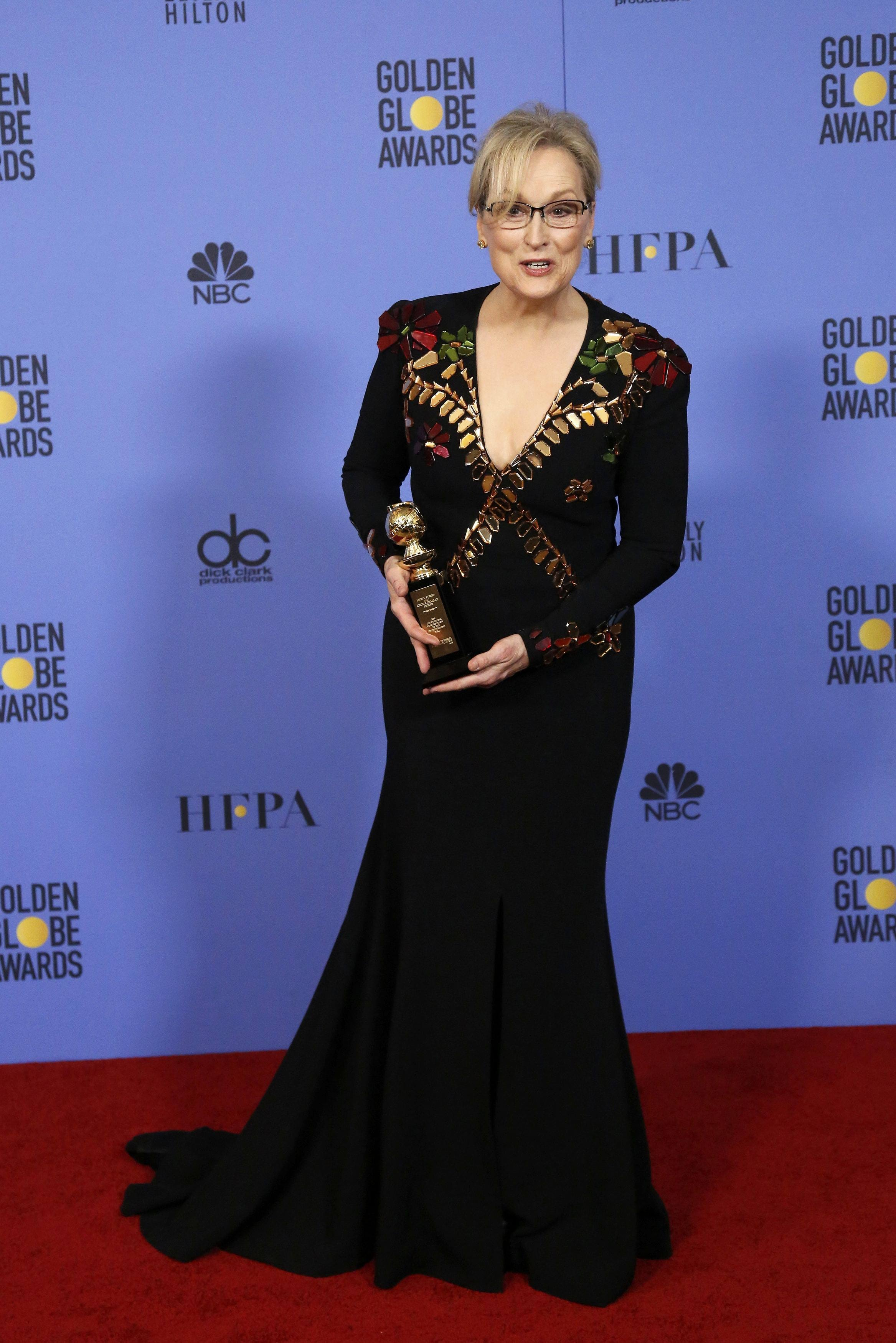 Meryl Streep holds the Cecil B. DeMille Award during the 74th Annual Golden Globe Awards in Beverly Hills, California, U.S., January 8, 2017. REUTERS/Mario Anzuoni