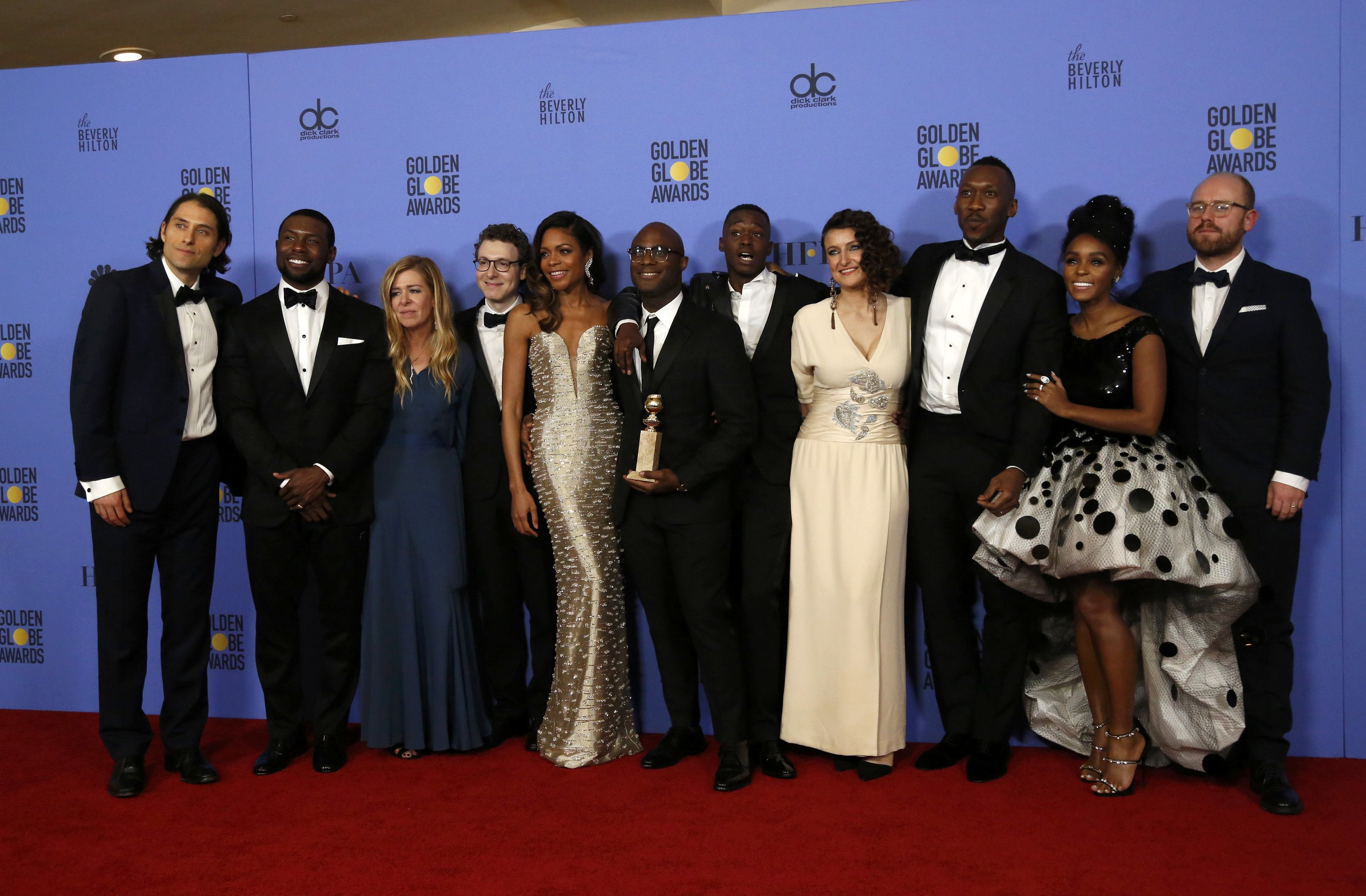 "Cast and crew of ""Moonlight"" poses backstage with their award at the 74th Annual Golden Globe Awards in Beverly Hills"