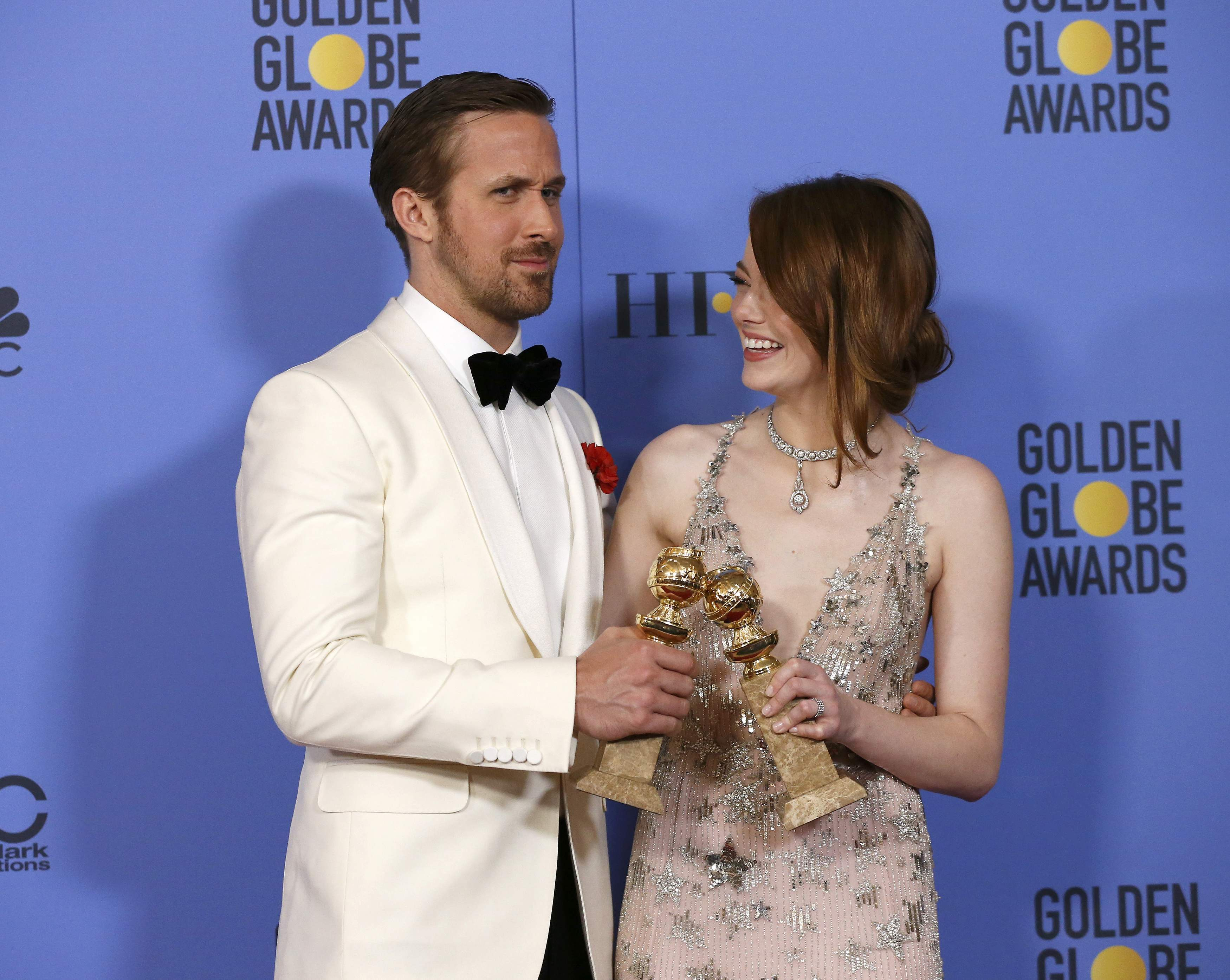 Ryan Gosling and Emma Stone pose with their awards during the 74th Annual Golden Globe Awards in Beverly Hills